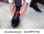 Man Puts On Shoes. Focus On Th...