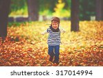 happy child playing pilot... | Shutterstock . vector #317014994
