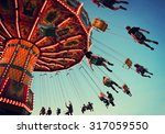 a swinging fair ride at dusk... | Shutterstock . vector #317059550