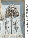 Small photo of statues of Adam and Eve with Apple tree in the facade of Italian Abbey Called Certsosa di Pavia