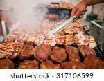 grilling meat with barbecue... | Shutterstock . vector #317106599