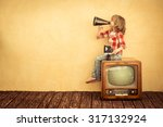 kid shouting through vintage... | Shutterstock . vector #317132924