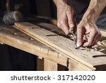 Closeup Of A Carpenter Hands...