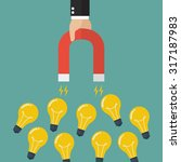 businessman holding magnet... | Shutterstock .eps vector #317187983