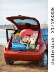 suitcases and bags in trunk of... | Shutterstock . vector #317193308
