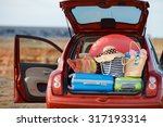 suitcases and bags in trunk of... | Shutterstock . vector #317193314