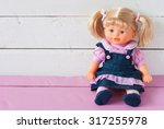 Cute Doll Sits On The...