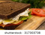 sandwich with fried bacon ... | Shutterstock . vector #317303738