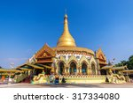 Small photo of Golden pagoda and temple , Kaba aye Pagoda (Yangon, Myanmar) with clear blue sky