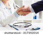 closeup of handshake of female... | Shutterstock . vector #317352014