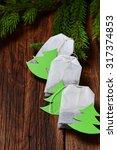 tea bag with christmas tree...   Shutterstock . vector #317374853