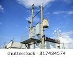 electric post against blue sky... | Shutterstock . vector #317434574