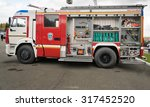 Small photo of Nizhny Tagil, Russia - Sept 11, 2015: Open side with the equipment of fire bluster tank truck AC 3,2 40/4 on chassis KAMAZ