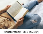 Woman In Blue Jeans Reading...