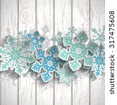 abstract blue snowflakes  with... | Shutterstock .eps vector #317475608