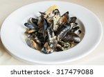 blue mussels white wine sauce  | Shutterstock . vector #317479088