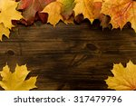Colorful Maple Leaves On Wooden ...