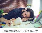Tired Editor Holding Disposabl...