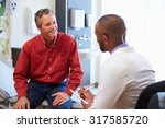 male patient and doctor have... | Shutterstock . vector #317585720