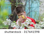 Small photo of teenage Boy with allergic rhinitis in spring garden