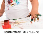 painted child's hand and colors ... | Shutterstock . vector #317711870