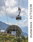 Small photo of AOSTA VALLEY, ITALY - AUGUST 06, 2015: The new SkyWay aerial tramway links the city of Courmayeur with Pointe Helbronner on the top of Mont Blanc massif
