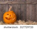 Smiling Carved Pumpkin On A...