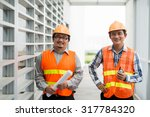 two smiling asian engineers at... | Shutterstock . vector #317784320