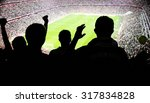 silhouettes of fans celebrating ... | Shutterstock . vector #317834828