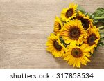 Sunflowers On Wooden Background