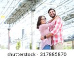 happy couple looking away while ... | Shutterstock . vector #317885870