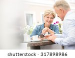 happy middle aged couple using... | Shutterstock . vector #317898986