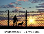 Silhouette Of A Soldier On The...