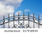 Forged Metal Fence Against The...