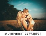 mom and son having fun by the... | Shutterstock . vector #317938934
