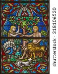 Small photo of MAREDSOUS, BELGIUM - August 30, 2015: Detail of a an old stained glass window in the abbey of Maredsous (Belgium). Depicted are Adam and Eve in the garden of Eden sharing an apple.