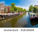 Canal And Bridge In Amsterdam....