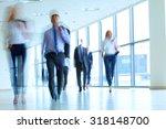 businesspeople walking in the... | Shutterstock . vector #318148700