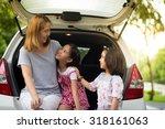 happy asian family sitting in... | Shutterstock . vector #318161063