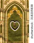 beads on a prayer mat | Shutterstock . vector #318205838