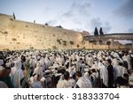 JERUSALEM - OCTOBER 14, 2014: Religious Jews sunrise prayer service at the Western Wall, Israel - stock photo