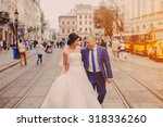 wedding couple walking in lviv... | Shutterstock . vector #318336260