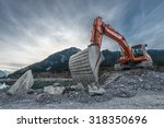 big orange digger on gravel... | Shutterstock . vector #318350696