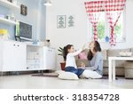 mom and daughter in the living... | Shutterstock . vector #318354728