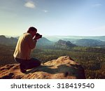 dark hair man is taking photo... | Shutterstock . vector #318419540