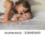 mother and newborn baby wake up ... | Shutterstock . vector #318485690