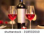 Glasses Of Red Wine In A...
