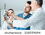 professional medical team with... | Shutterstock . vector #318559694