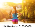brunette young woman running in ...   Shutterstock . vector #318565430
