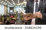 businessman using the tablet on ...   Shutterstock . vector #318614150